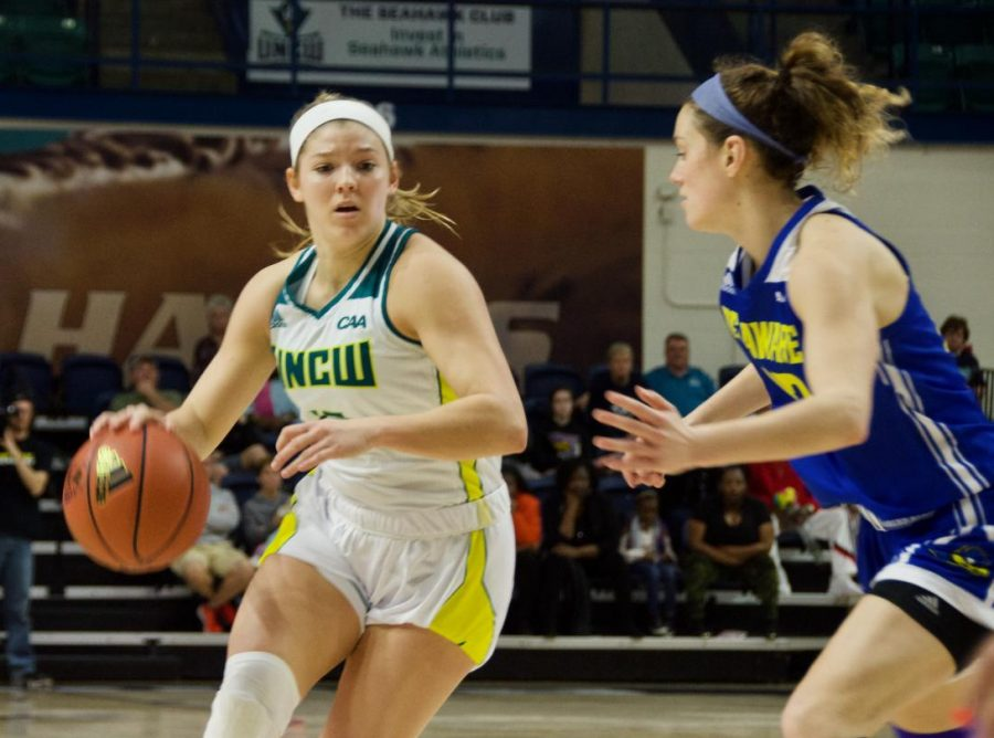 Lacey Suggs (13) attempts to drive past a defender during UNCW's contest against Delaware in Trask Coliseum on Feb. 24, 2019.