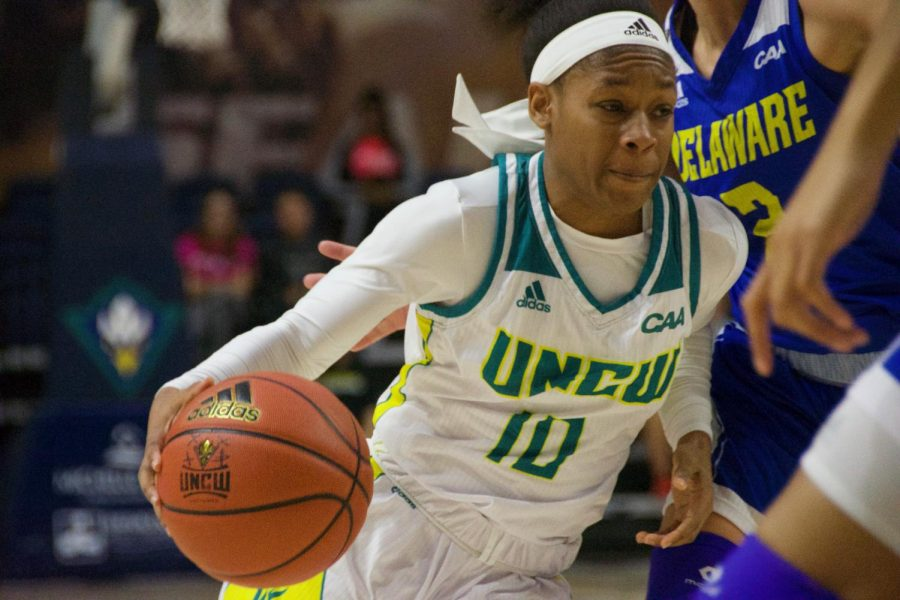 Ahyiona Vason (10) drive in to the basket during UNCW's contest against Delaware in Trask Coliseum on Feb. 24, 2019.