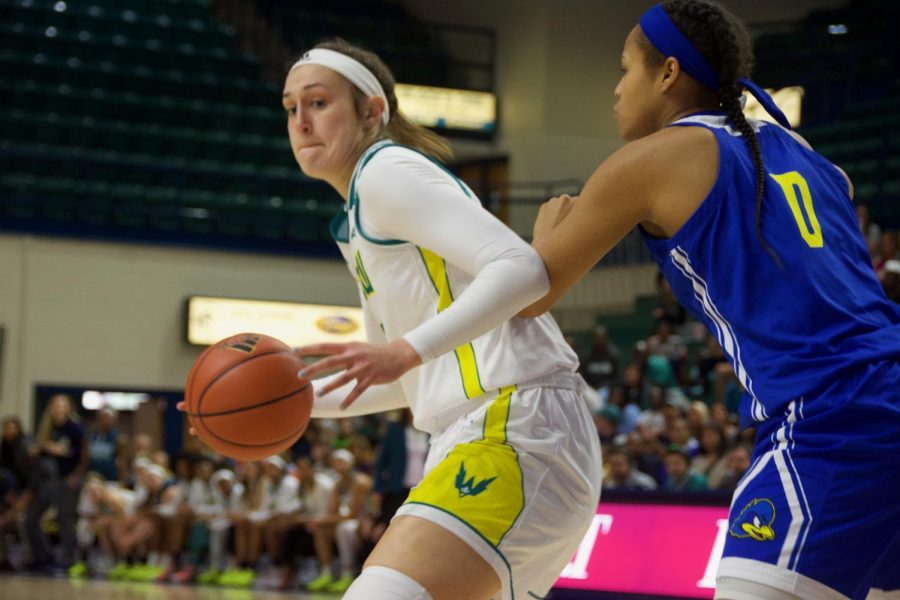 Carol-Anne+Obusek+%2832%29+backs+in+for+a+layup+during+UNCW%27s+contest+against+Delaware+in+Trask+Coliseum+on+Feb.+24%2C+2019.+