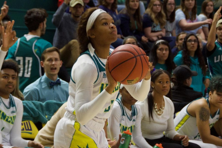 Ashli Jeune (0) attempts a three-pointer during UNCW's contest against Delaware in Trask Coliseum on Feb. 24, 2019.