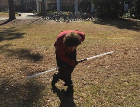 Beau Carlson, double-bladed lightsaber in hand, takes a bow outside Fisher Student Center on Feb. 6