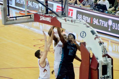 Devontae Cacok (15) goes for a layup against College of Charleston inside TD Arena on March 2, 2019.