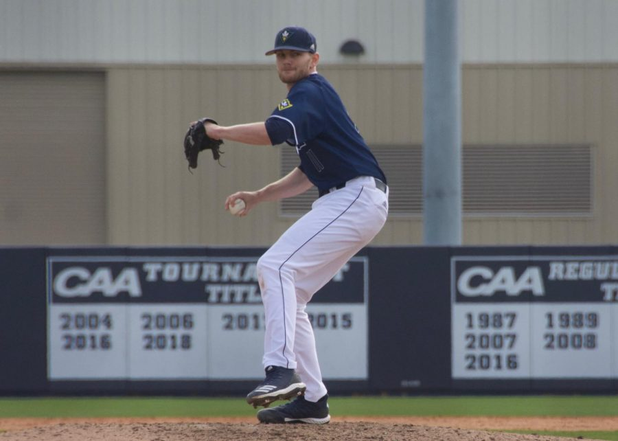Blake Deatherage (11) pitches during UNCW's matchup against Valparaiso at Brooks Field on March 3, 2019.