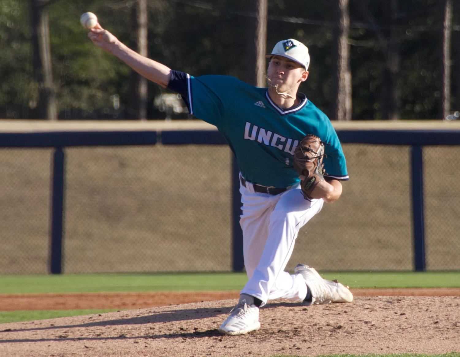 Landen Roupp (14) pitches during UNCW's matchup against Toledo on Wednesday night at Brooks Field.