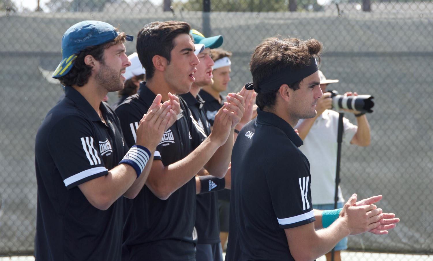 The+Seahawks+cheer+on+their+teammates+during+UNCW%27s+final+doubles+match.+