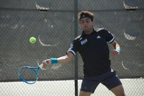Agustin Savarino during UNCW's match against South Carolina State on March 25, 2019.