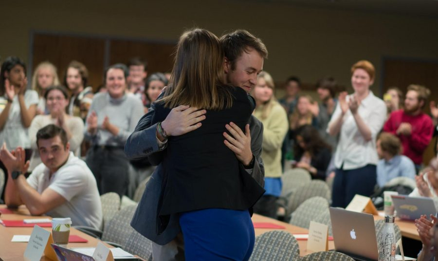 Appalachian State students embrace after the school's student government passed a Climate Neutrality bill on March 13.
