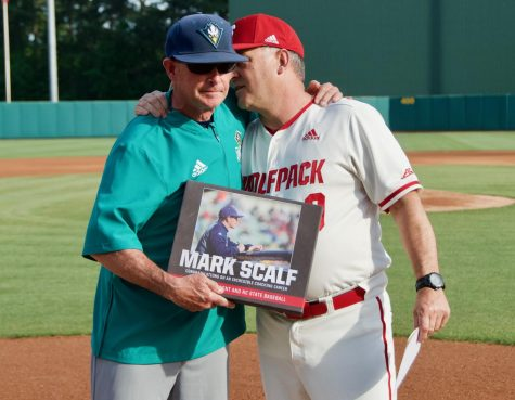 NC State coach Elliott Avent (right) honors UNCW coach Mark Scalf (left) prior to Tuesday's game at Doak Field on April 30, 2019.