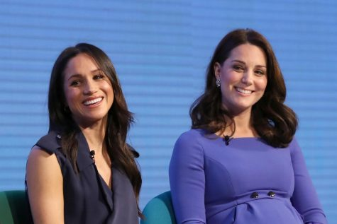 Meghan Markle, left, and Catherine, Duchess of Cambridge, attend the first Royal Foundation Forum on February 28, 2018, in London. (Rota/i-Images/Zuma Press/TNS)