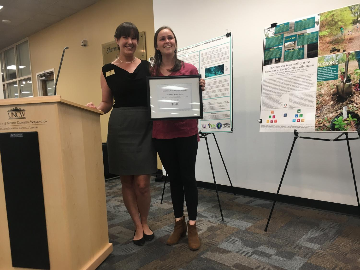 From left to right: Kathryn Pohlman, Environmental Health Safety Sustainability Captain, and Alexis Otts, psychology major who was awarded for her work on her sustainability project.