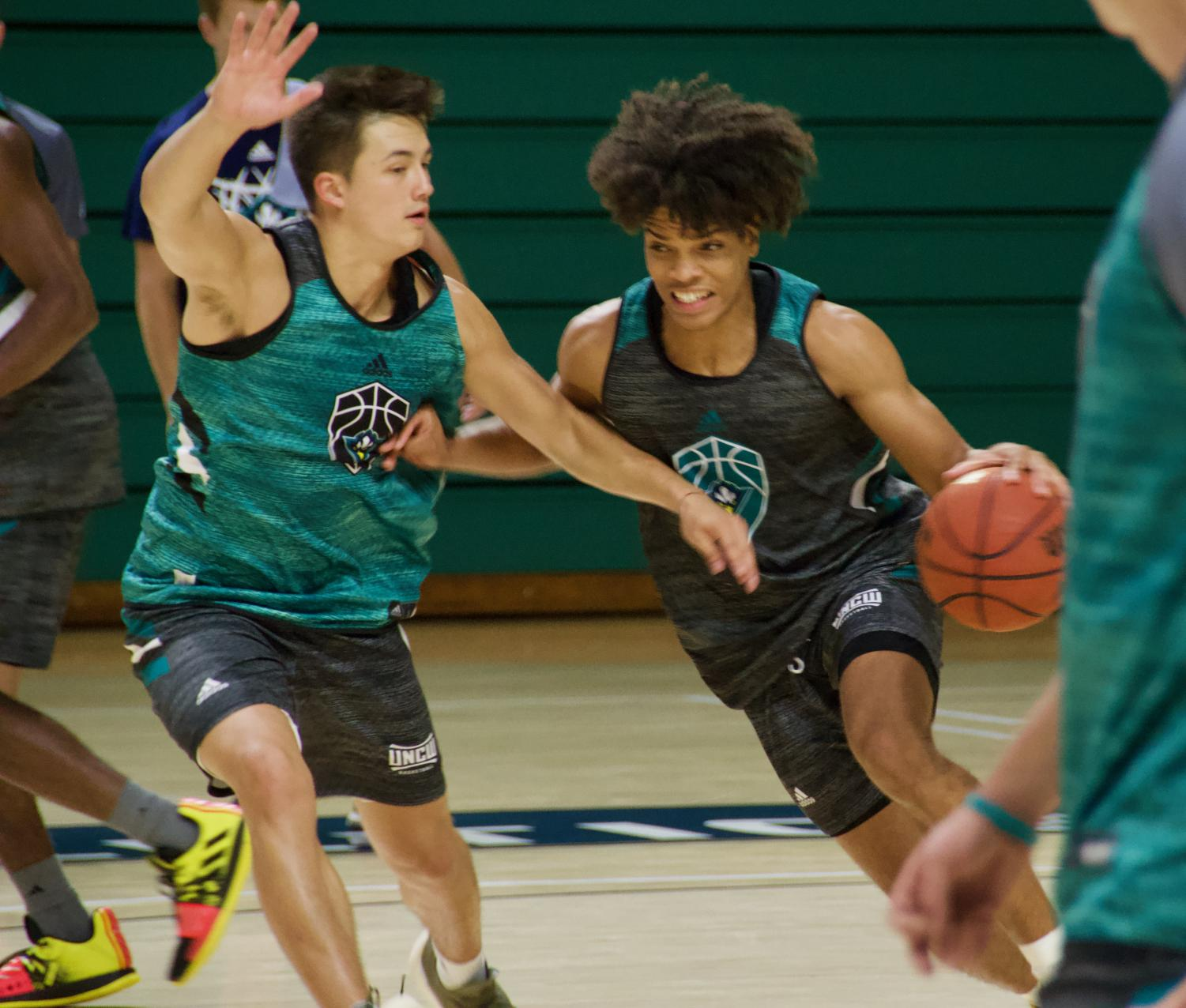 Kai Toews guards Shykeim Phillips during UNCW's first official practice of the 2019-20 season on Sep. 26, 2019.