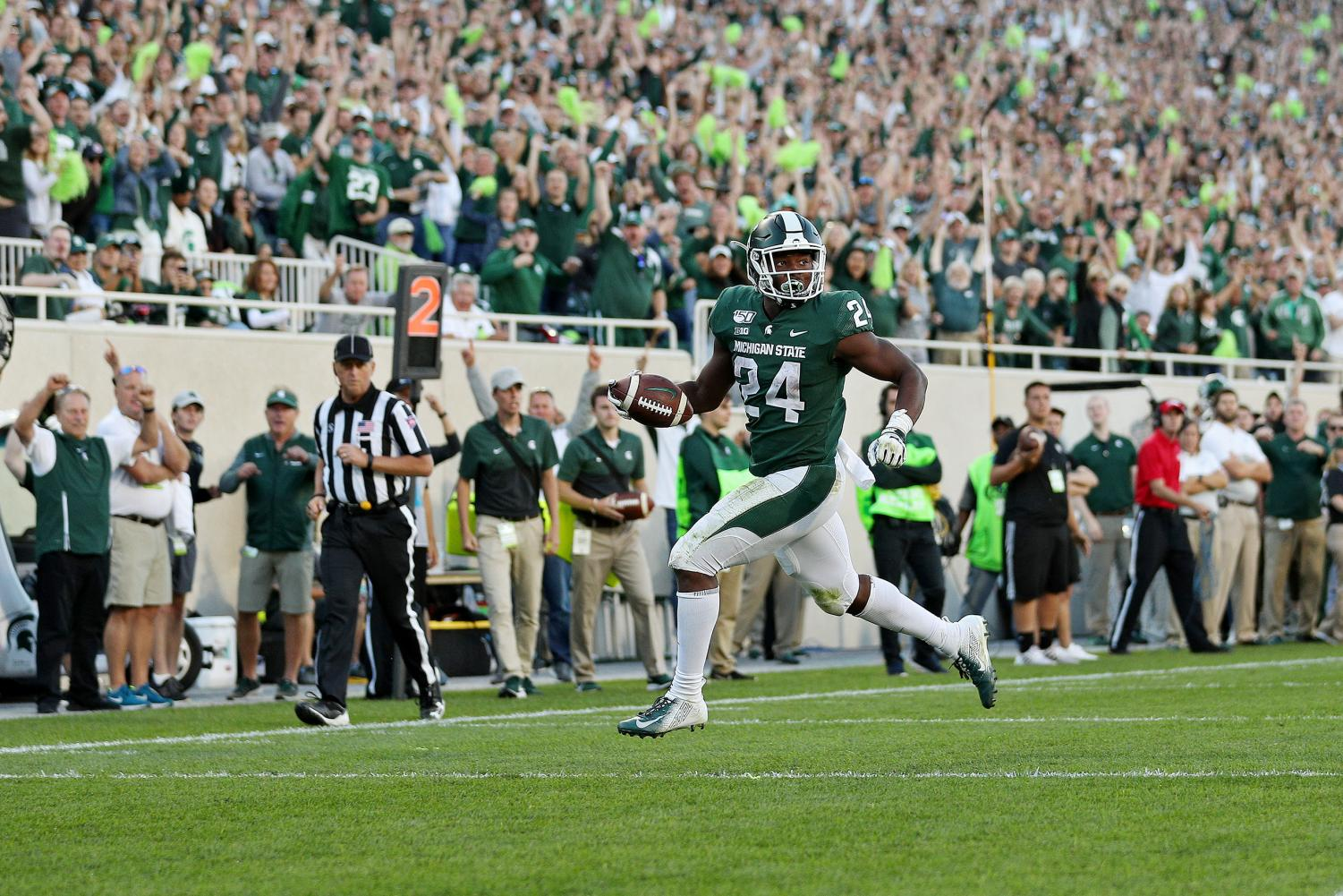 Michigan State running back Elijah Collins (24) runs for a touchdown in the fourth quarter against Arizona State.