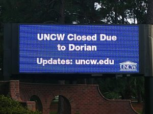 UNCW digital info sign on South College Road announcing campus closure due to Hurricane Dorian,