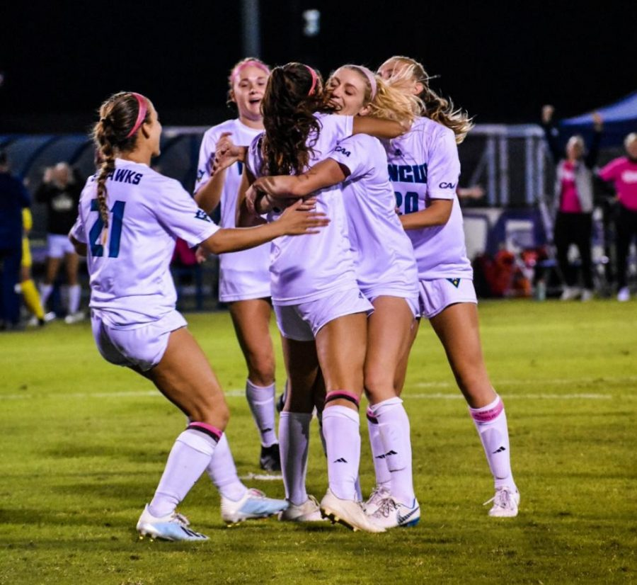 The+UNCW+women%27s+soccer+team+celebrates+during+its+matchup+with+James+Madison+on+Oct.+24%2C+2019.+