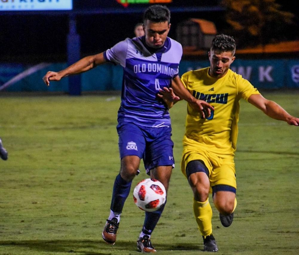 Alejandro Saez (18) battles with Old Dominion defender Jose Olmos (4) during UNCW's matchup with the Monarchs on October 9, 2019 at UNCW Soccer Stadium