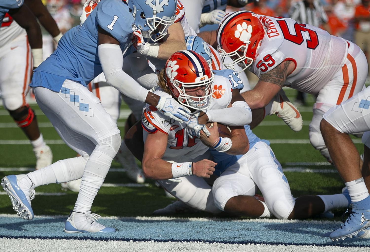 Clemson quarterback Trevor Lawrence (16) scores a touchdown on a three-yard run to tie North Carolina 14-14 in the second quarter on Saturday, September 28, 2019 at Kenan Stadium in Chapel Hill, N.C.