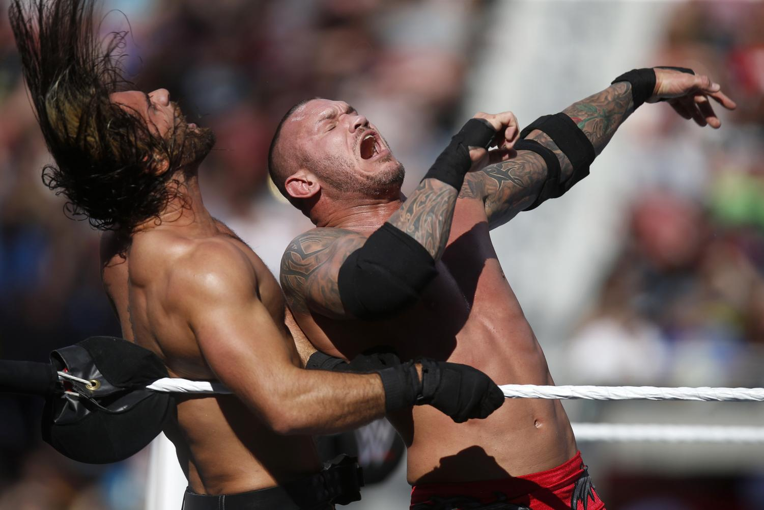 WWE's Randy Orton, right, hits Seth Rollins during WrestleMania at Levi's Stadium on Sunday, March 29, 2015 in Santa Clara, Calif.