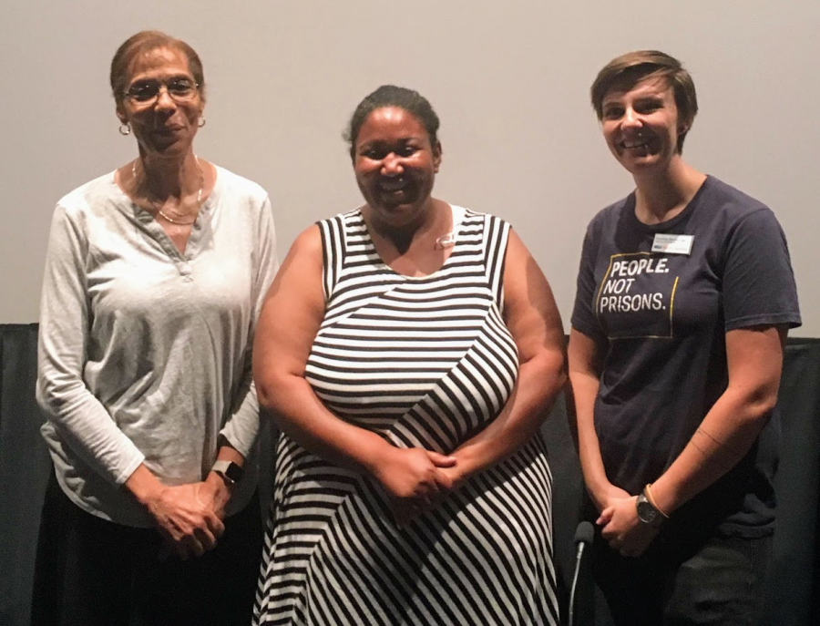 Caroline Morin-Gage (left), Ashley Powell (center), and Babette Boyd (right) pose for a photo after lecturing about the cash-bail system in the U.S.