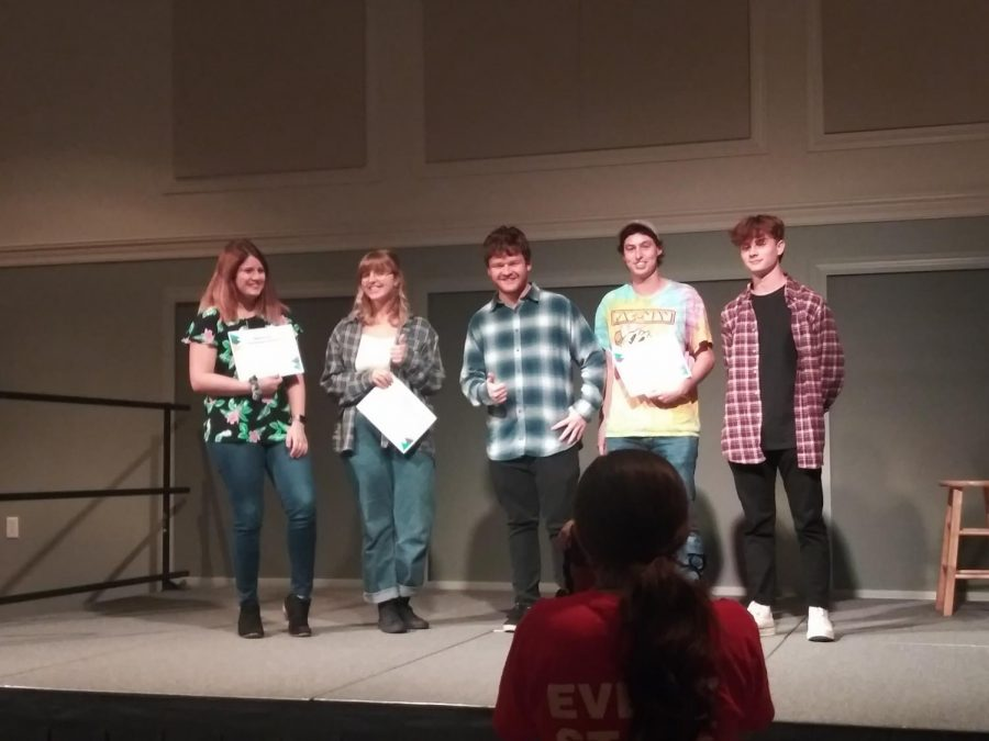 From left, Rachel Wilcox, Kelsey Singer, Matt Coghlan, Ian Zeph, and Logan Maletta on stage at Last Seahawk Standing 2019.
