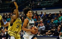 Shykeim Phillips goes in for a layup during UNCW's matchup with N.C. Wesleyan on Nov. 19, 2019.