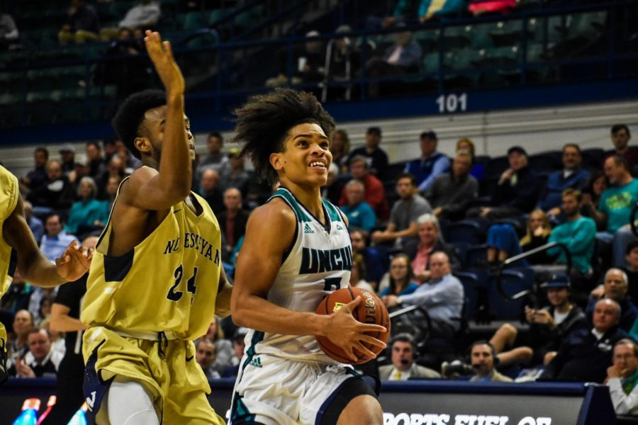 Shykeim+Phillips+goes+in+for+a+layup+during+UNCW%27s+matchup+with+N.C.+Wesleyan+on+Nov.+19%2C+2019.