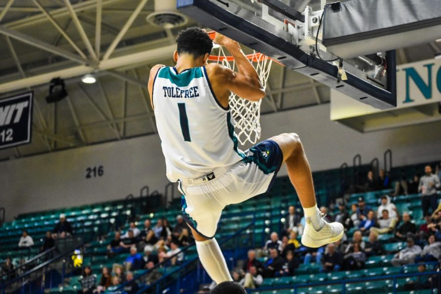Brian Tolefree slams one home during UNCW's matchup with N.C. Wesleyan on Nov. 19, 2019.