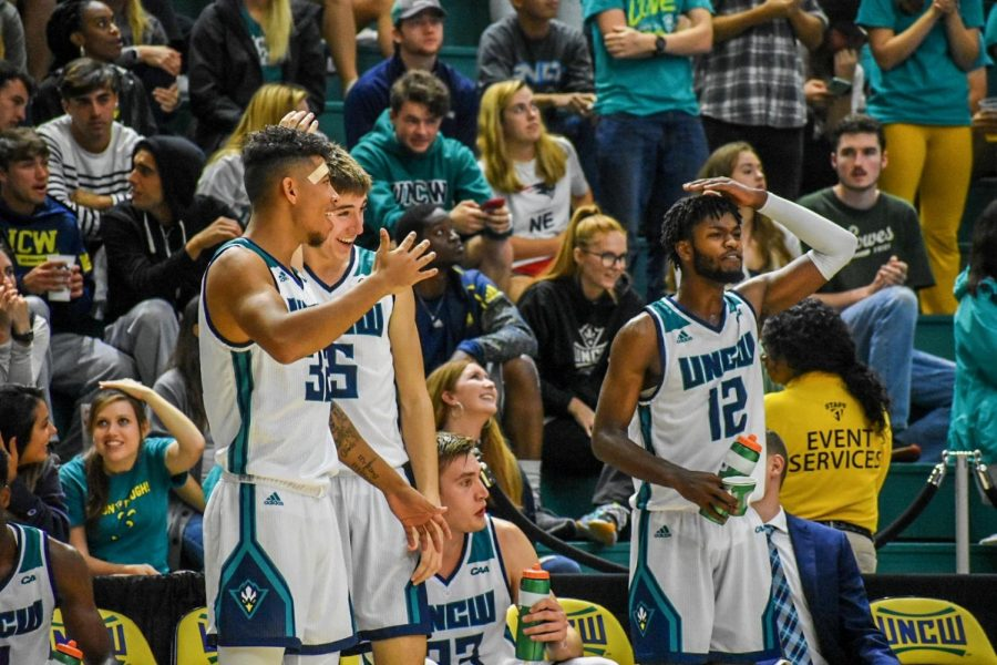 UNCW celebrating after another posterizing dunk against Johnson & Wales.