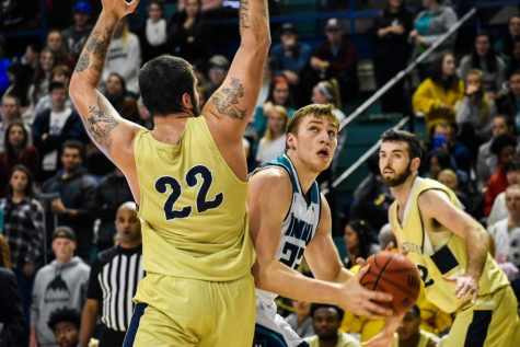 Marten Linssen attempts to go up for a shot during UNCW's matchup with N.C. Wesleyan on Nov. 19, 2019.