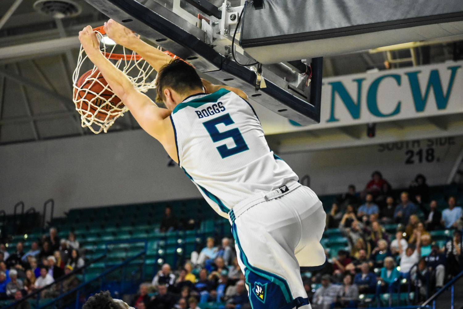 Jake Boggs slams one down during UNCW's matchup with N.C. Wesleyan on Nov. 19, 2019.
