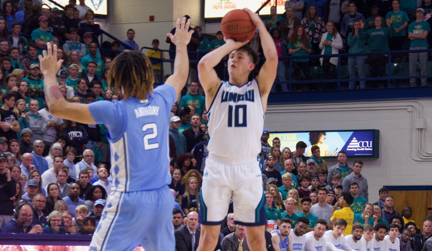 Kai Toews (10) attempts a three-pointer during UNCW's matchup with North Carolina on Nov. 8, 2019 at Trask Coliseum.
