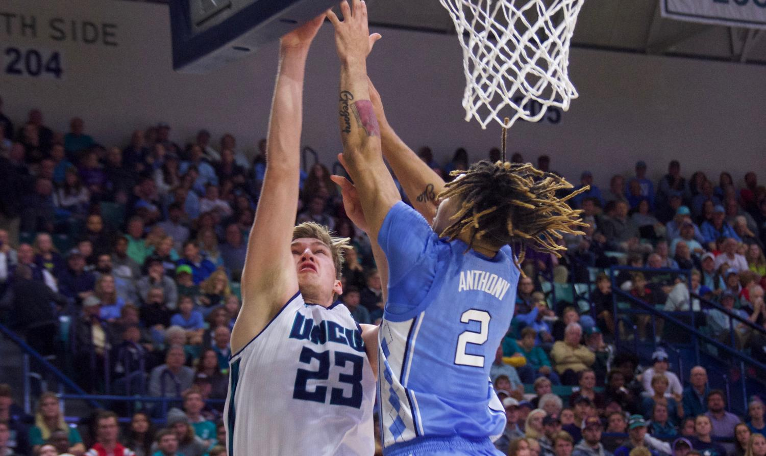 Marten Linssen (23) attempts to shoot over Cole Anthony (2) during UNCW's matchup with North Carolina on Nov. 8, 2019 at Trask Coliseum.