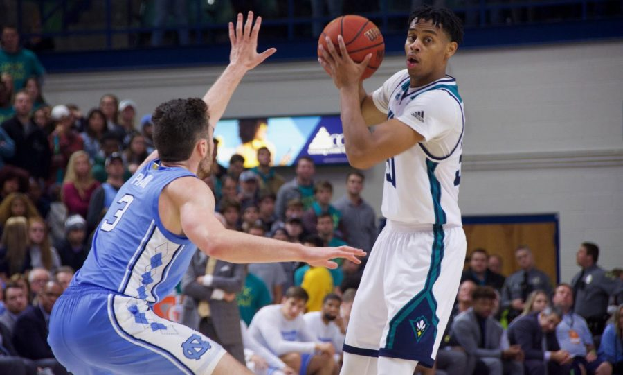 Jaylen Sims is guarded by Andrew Platek (3) during UNCW's matchup with North Carolina on Nov. 8, 2019 at Trask Coliseum.