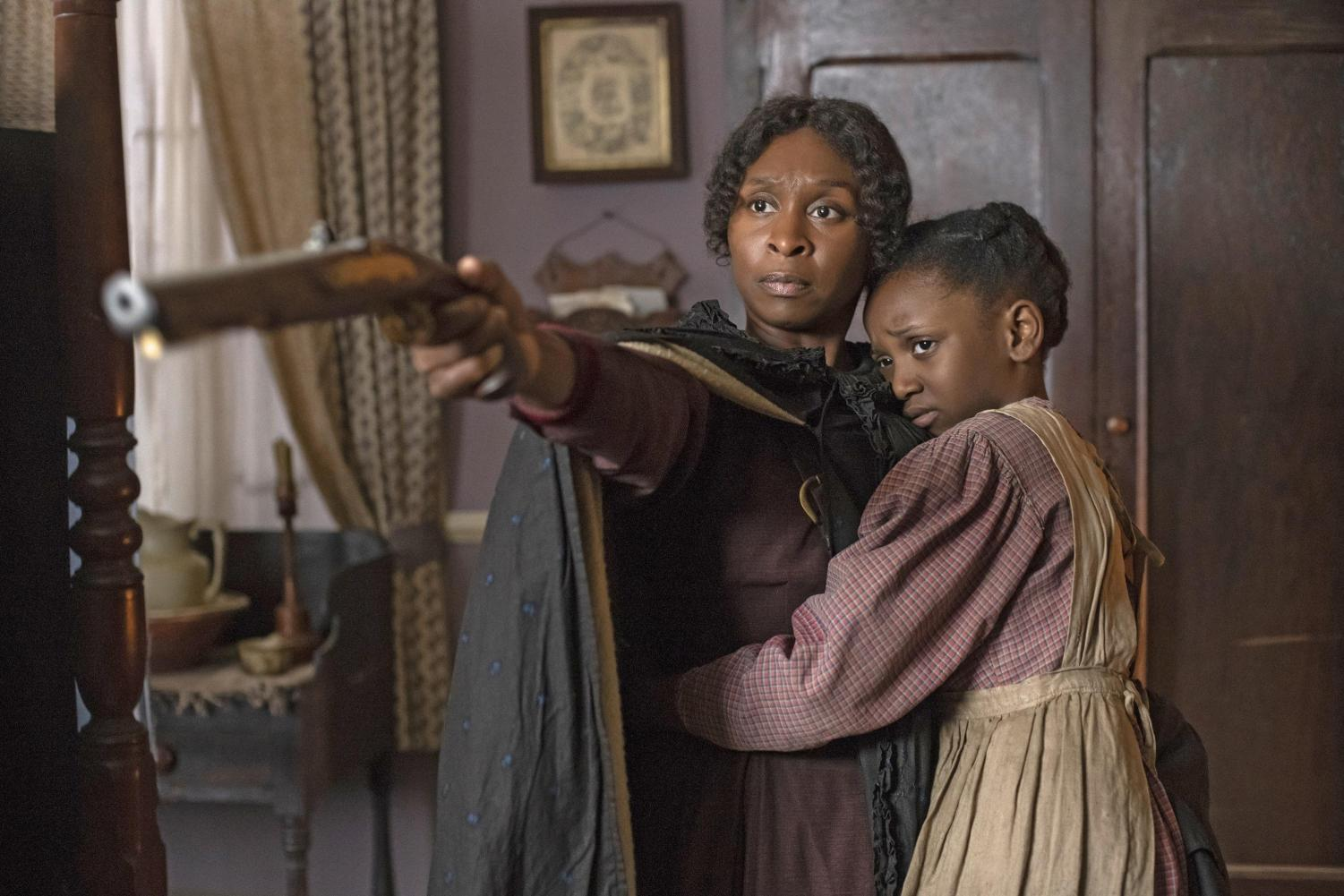 Cynthia Erivo as Harriet Tubman and Aria Brooks as Anger at age 8 in