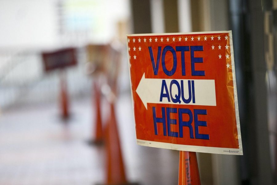 A sign points voters to an early voting location at ACC-Highland Mall.