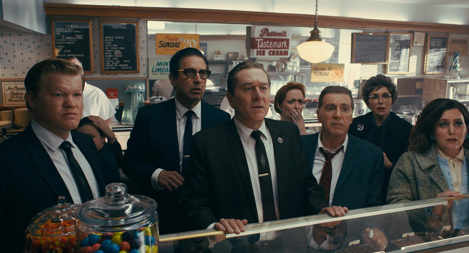 From left to right, during a break in the trial of Jimmy Hoffa, Chuckie O'Brien (Jesse Plemons), Bill Bufalino (Ray Romano), Frank Sheeran (Robert De Niro) and Hoffa (Al Pacino) are shocked at the news of JFK's assassination in a scene from