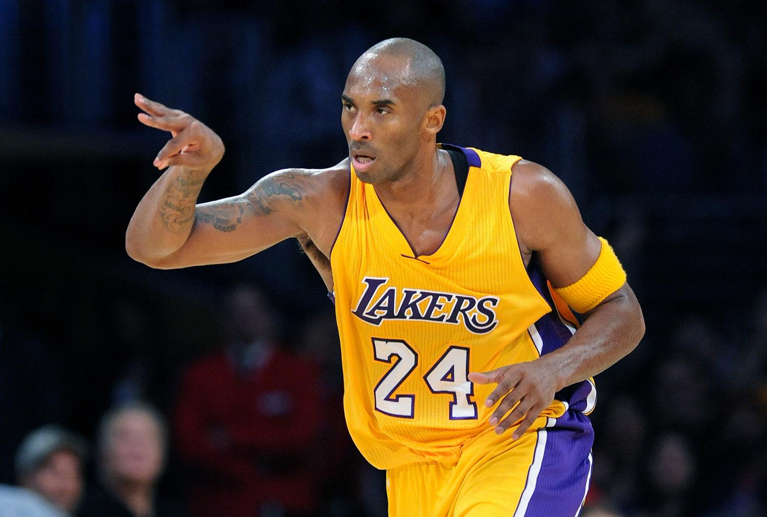 The Los Angeles Lakers' Kobe Bryant celebrates his 3-pointer against the Minnesota Timberwolves in the second quarter at Staples Center in Los Angeles on Wednesday, Oct. 28, 2015.
