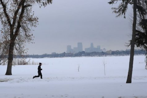 A runner endures yet another sunless day in Minnesota along Bde Maka Ska Tuesday, Jan. 28, 2020, in Minneapolis.