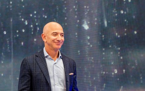 Jeff Bezos, head of Amazon, can be seen on the fringes of the company's novelties event on Sept. 25, 2019. Bezos recently pledged $10 billion toward climate change, a good example of how the rich can help the environment.