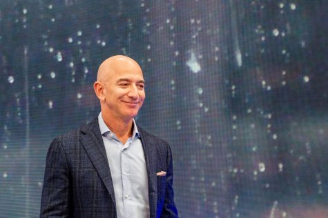 Jeff Bezos, head of Amazon, can be seen on the fringes of the company
