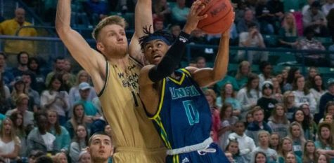 Ty Gadsden (0) attempts to shoot against a defender during UNCW's homecoming matchup against William & Mary on Feb. 8, 2020 at Trask Coliseum.