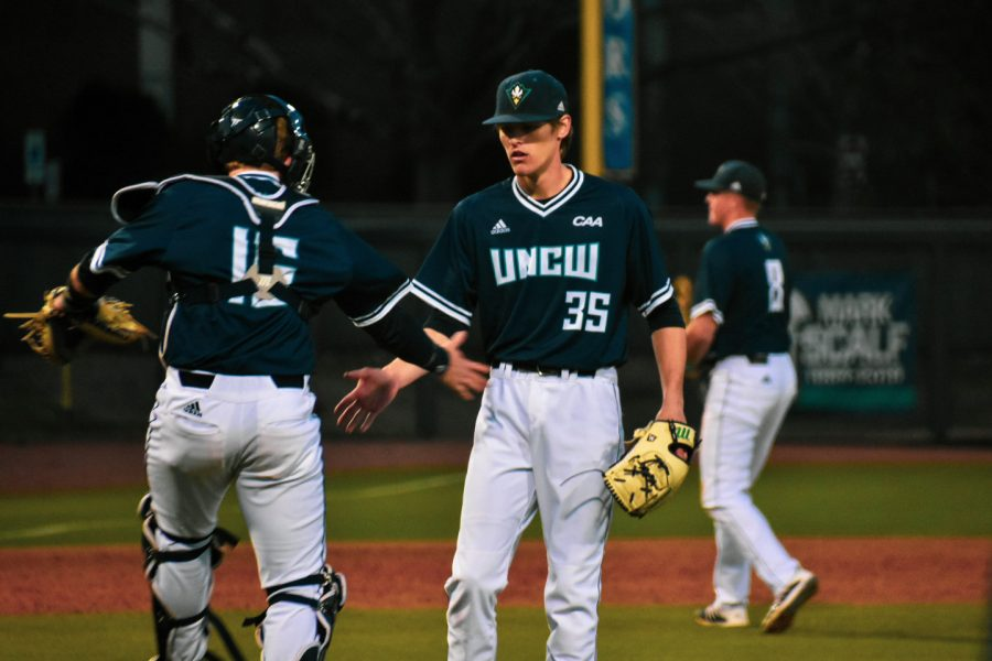 From left: Matt Suggs (15), Adam Smith (35) and Cole Weiss (8) during UNCW's matchup with Marshall on Feb. 23, 2020 at Brooks Field.
