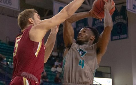 Mike Okauru (4) during UNCW's matchup with Elon on Feb. 6, 2020 at Trask Coliseum.