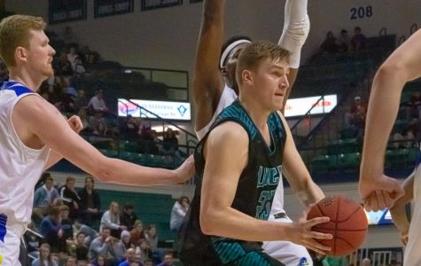 Marten Linssen battles Delaware defenders during UNCW's matchup with the Blue Hens on Feb. 29, 2020 at Trask Coliseum.