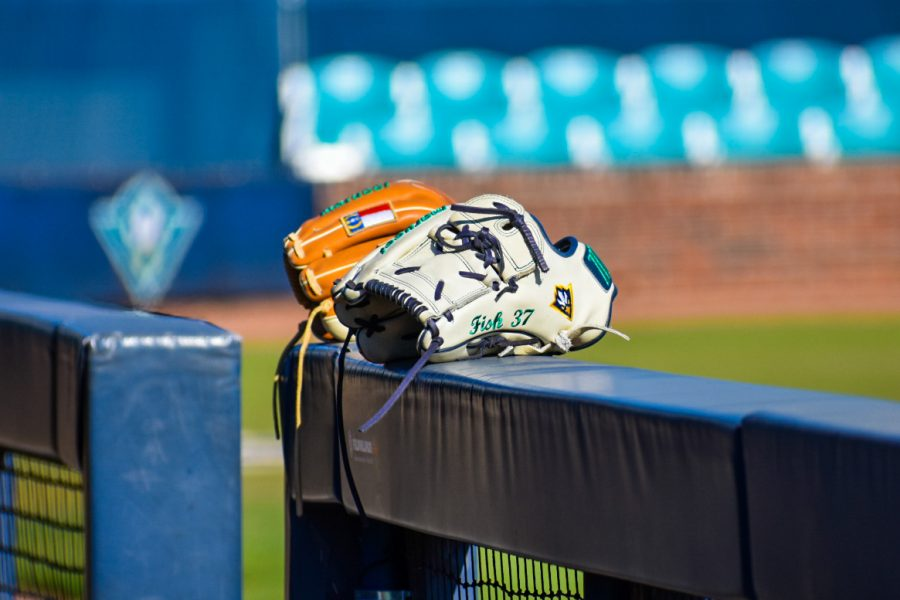 A pair of UNCW gloves during the Seahawks' matchup with Marshall on Feb. 22, 2020 at Brooks Field.
