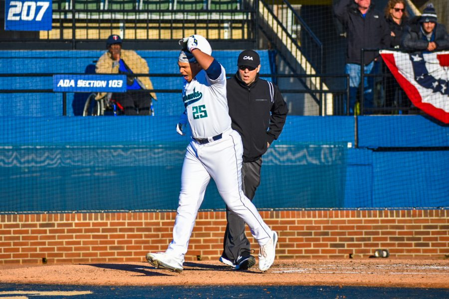 Ron+Evans+%2825%29+crosses+home+plate+during+UNCW%27s+Opening+Day+matchup+with+Dayton+on+Feb.+14%2C+2020+at+Brooks+Field