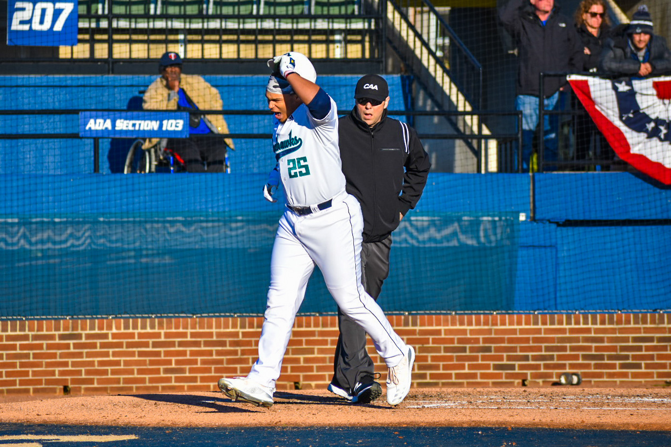 Ron Evans (25) crosses home plate during UNCW's Opening Day matchup with Dayton on Feb. 14, 2020 at Brooks Field