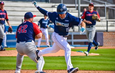 Matt Suggs (15) crosses first base during UNCW's matchup with Dayton on Feb. 16, 2020 at Brooks Field