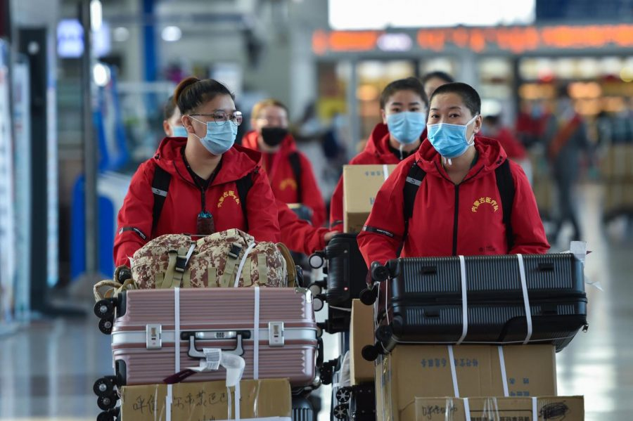 Medical team members prepare to check in at Hohhot Baita International Airport before leaving for Hubei Province in Hohhot, capital of north China's Inner Mongolia Autonomous Region, on Tuesday, Feb. 18, 2020. The seventh batch of medical workers from Inner Mongolia Autonomous Region to Hubei Province departed Tuesday to help the novel coronavirus control efforts there. (Liu Lei/Xinhua/Zuma Press/TNS)