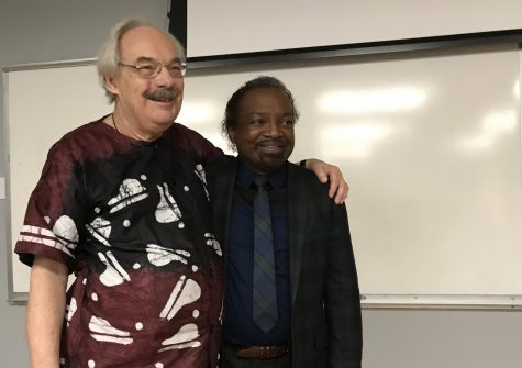 "Dr. Paul E. Lovejoy (left) and Dr. Booksie S. Harrington (right) -- both members of the Harriet Tubman Institute at York University -- embrace each other onstage after Lovejoy's presentation ""Slavery in the Global Diaspora of Africa"" the evening of March 5 at UNCW's Randall Library."