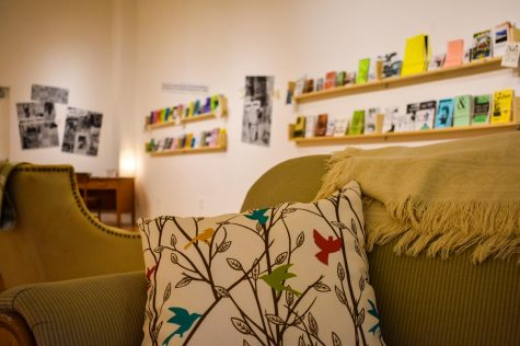 The Zine Gallery opened February 27 in the Cultural Arts Building main gallery area, featuring comfy couches to encourage visitors to engage with the exhibits. Photo by Zachary Kilby.